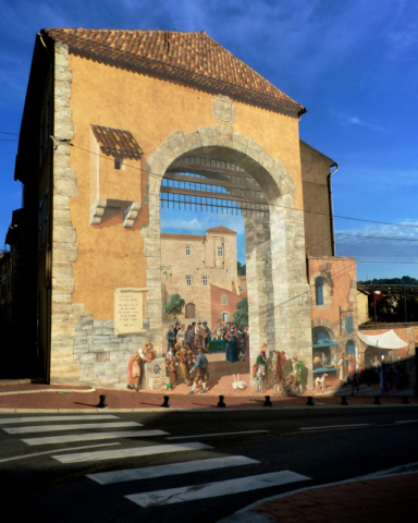 Entering Carcès, one of many clever murals awaits visitors. This one portrays the town as it would have looked in another era. Photo by Stacy Silverwood.