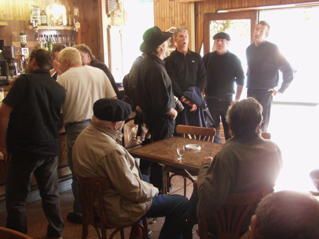 Singers drop into a local café.